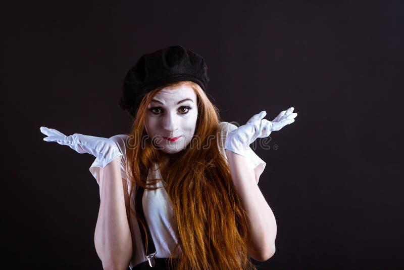 Mime Girl Shrug. A redhead mime girl shrugging stock photos