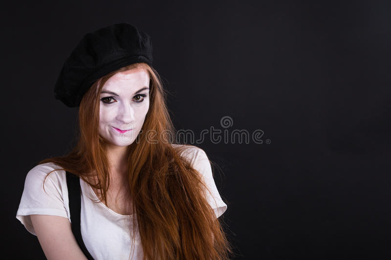 Mime Girl Smirk. A redhead mime girl smirking royalty free stock images