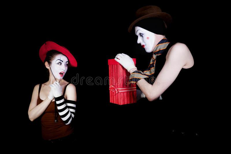 Mime gives gift with red box stock photography