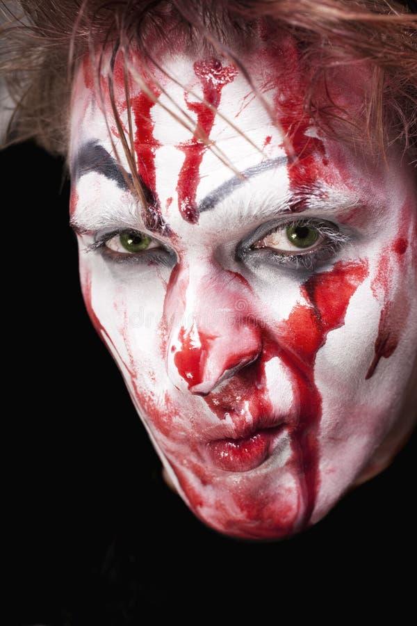 Mime Green-eyed com sangue na face fotografia de stock royalty free
