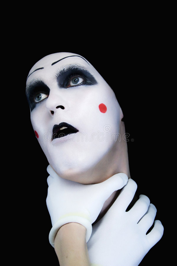 Mime with hands on a neck. On a black background royalty free stock images