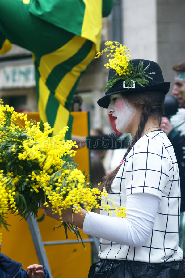 Mime with mimosa. Montenegro, Herceg Novi - 01/31/2016. The festive opening of the 47th festival of mimosa in the city of Herceg Novi. The event is held annually royalty free stock photos