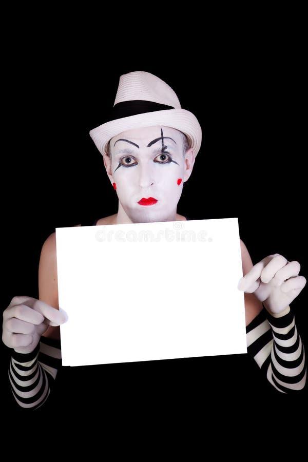 Mime nas luvas listradas que prendem o espaço em branco branco imagem de stock royalty free