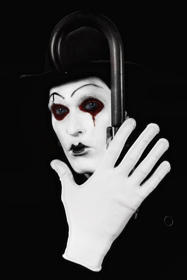 Mime que sostiene un bastón en su mano imágenes de archivo libres de regalías