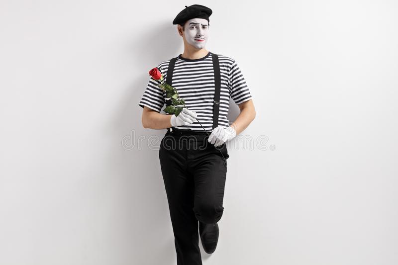 Mime with a rose flower stock photo