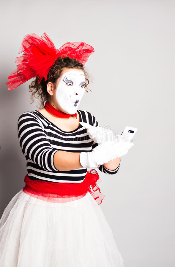 Mime with smartphone. Concept of April Fools Day. Mime with smartphone. Concept of April Fools Day royalty free stock image
