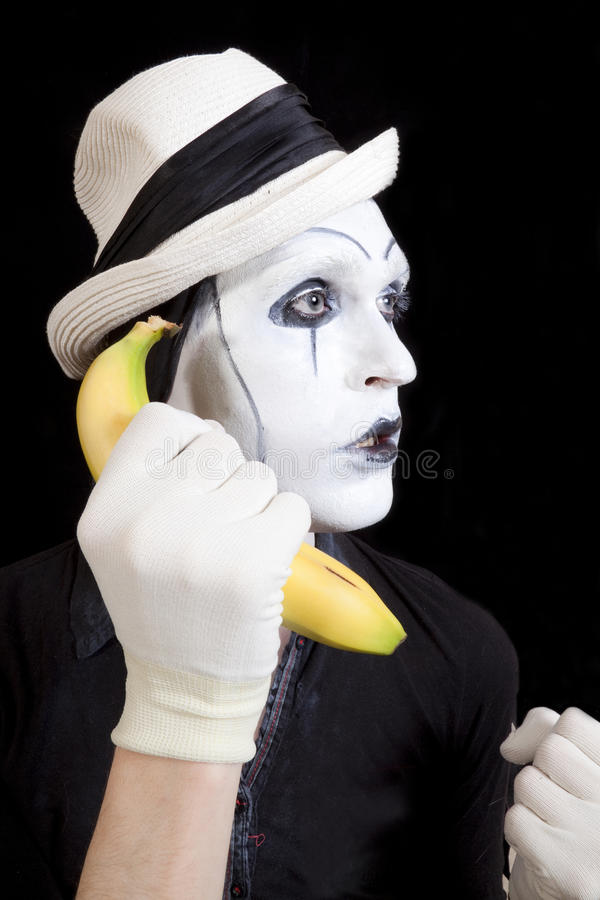 Download Mime In White Hat Holding A Banana In His Hand Stock Image - Image: 25969443