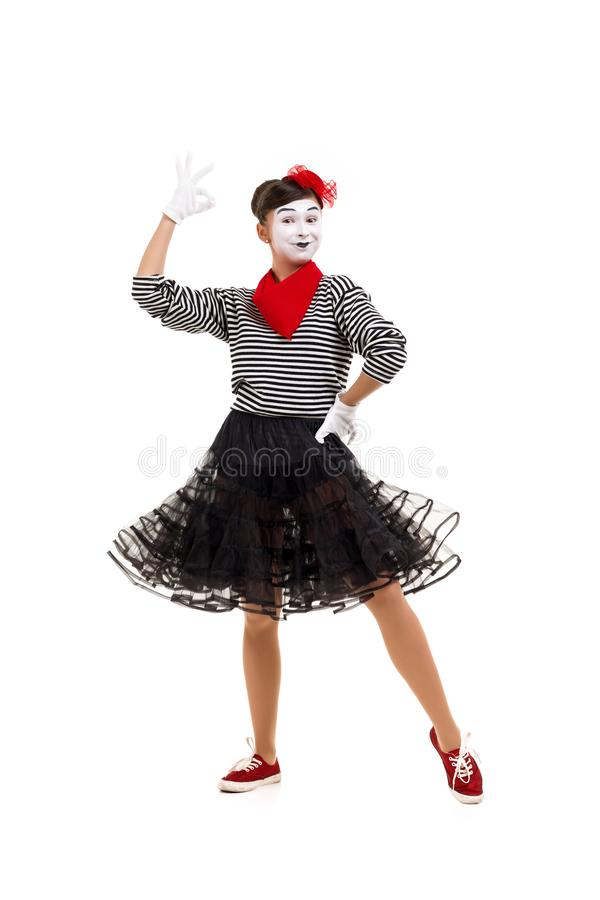 Mime woman artist looking at camera stock images