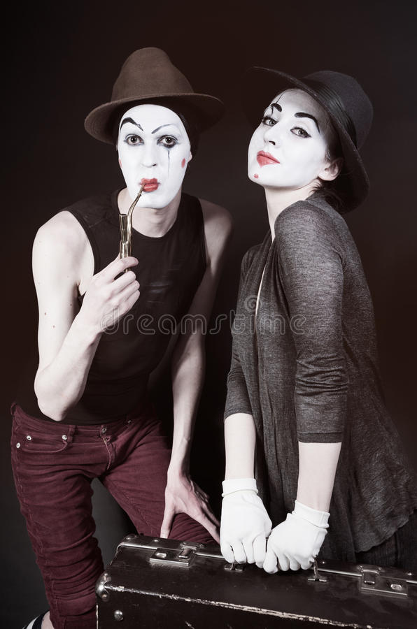 mimes woman and man with suitcase royalty free stock images