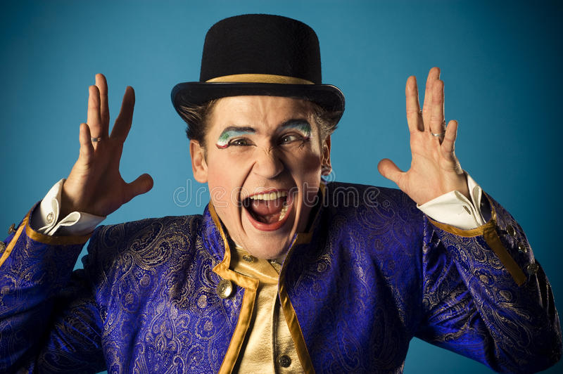 Mimics an actor. Portrait of the actor on a blue background royalty free stock photos