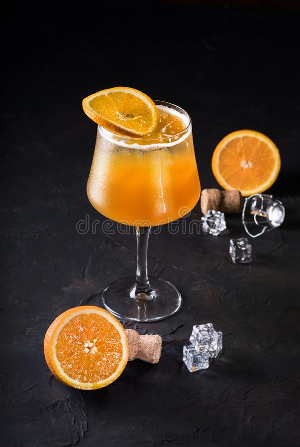 Mimosa cocktail in a champagne glass with orange juice and sparkling wine decorated with lavender leaves and orange royalty free stock image