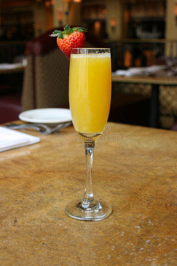 Mimosa cocktail glass royalty free stock photography