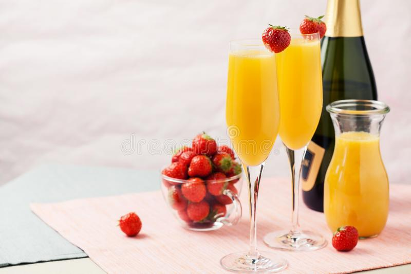 Mimosa cocktail and strawberries stock photography