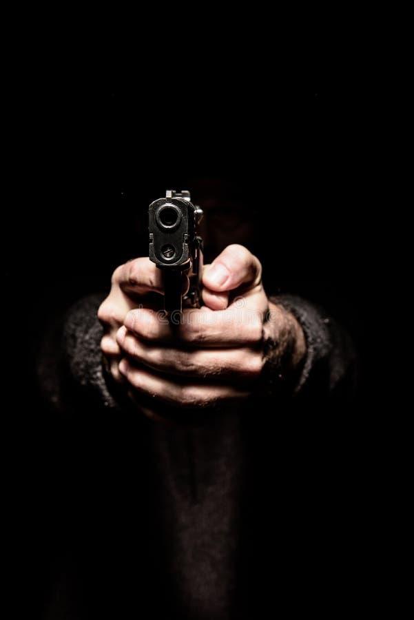 Minaccia con un'arma da fuoco immagini stock