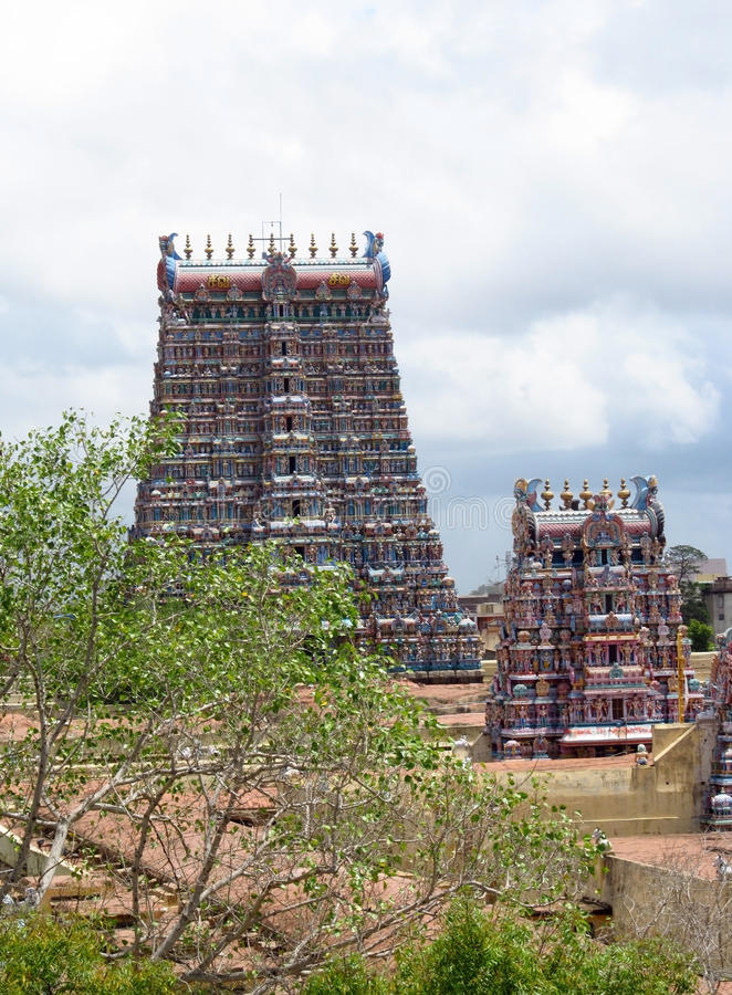 Minakshi hindu temple. In Madurai India. Colored hindu gods statue on the wall of hinduist temple with ornament and decorations. Man and woman figure, statues stock images