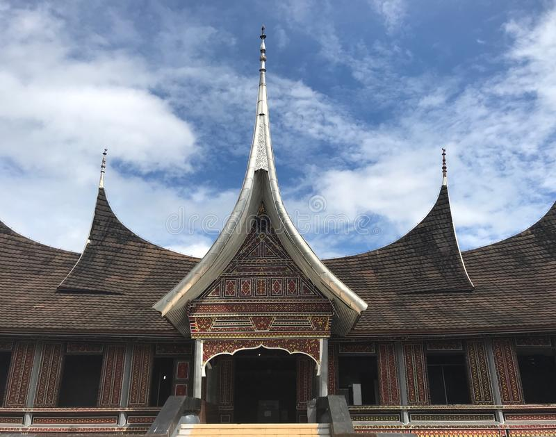 Minangkabau Architecture Padang Indonesia. On the island of Sumatra in Indonesia, traditional Minangkabau architecture with spires and intricate details located royalty free stock photography