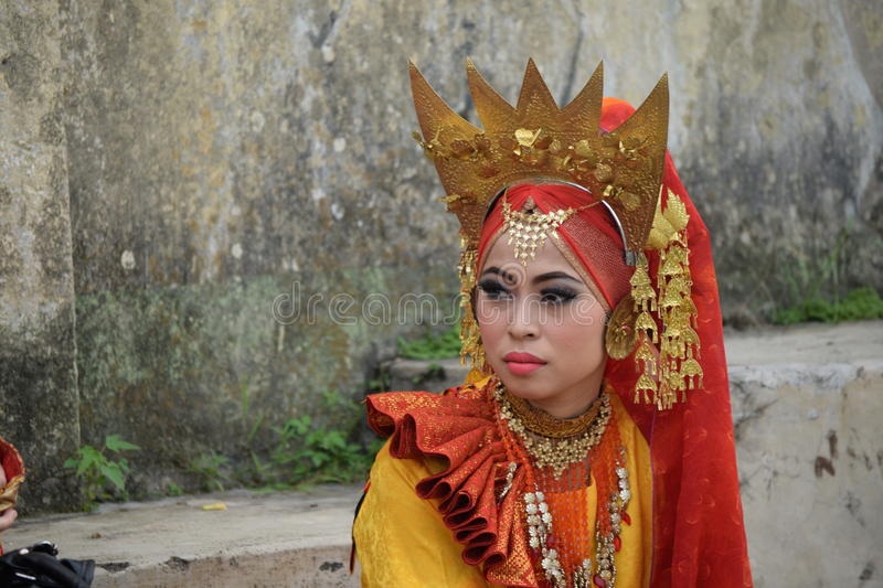 Minangkabau girl in yellow dance costume royalty free stock photography