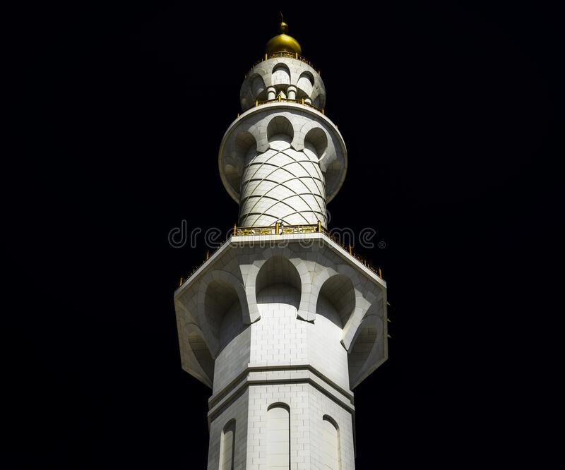 Minaret at night with a golden dome royalty free stock photos