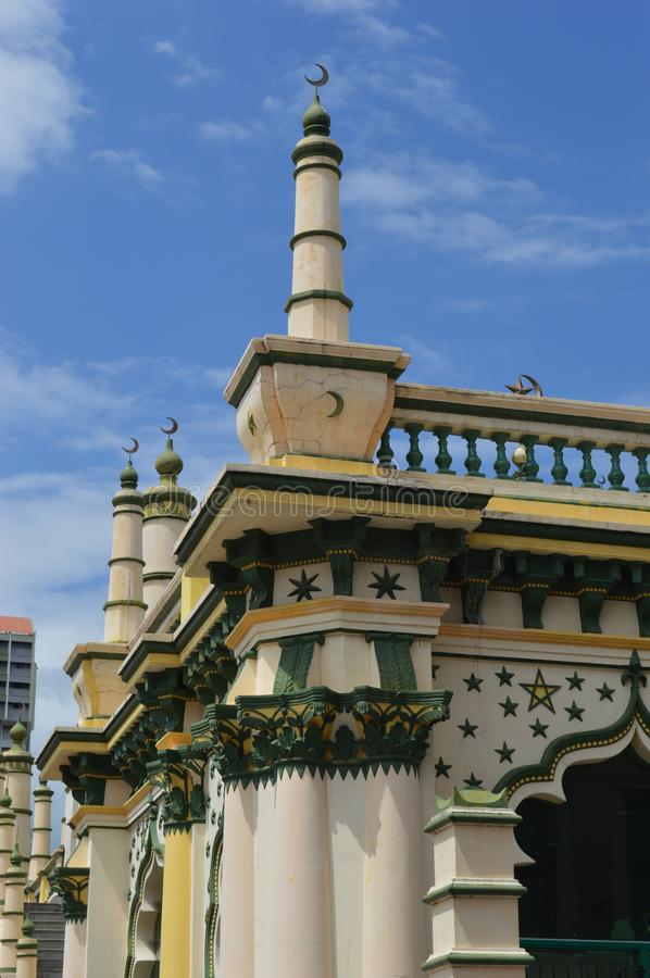 Masjid Abdul Gafoor mosque, little india Singapore. Minaret and architectural detail on the Masjid Abdul Gafoor mosque Little India singapore yellow green and stock photography