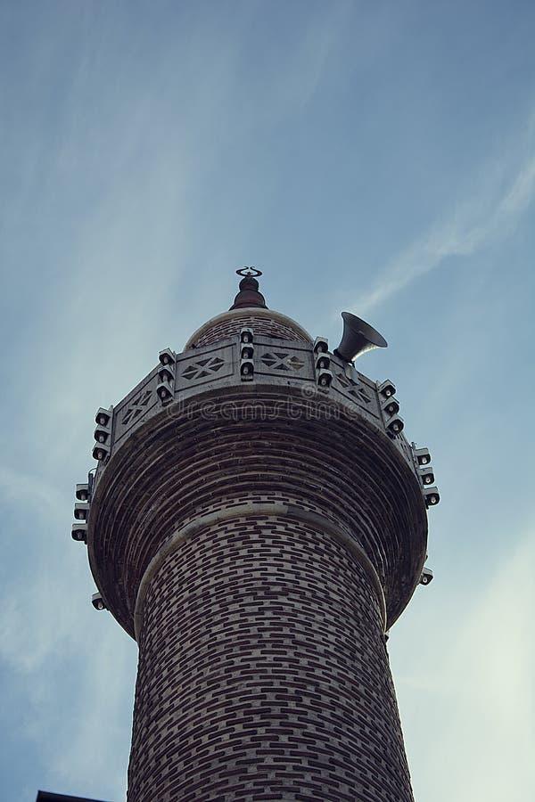 minaret Atendimento à oração fotos de stock