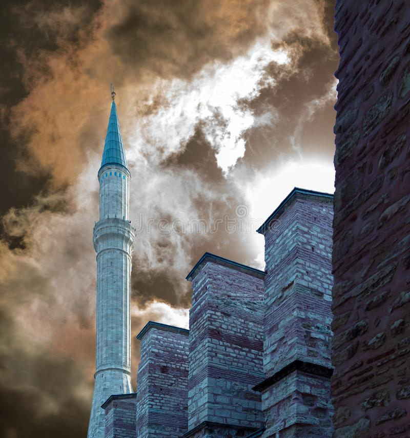 Minaret at the city wall before a dramatic sky shortly before the setting of the sun. Minaret at the city wall before a dramatic sky shortly before the setting royalty free stock photo