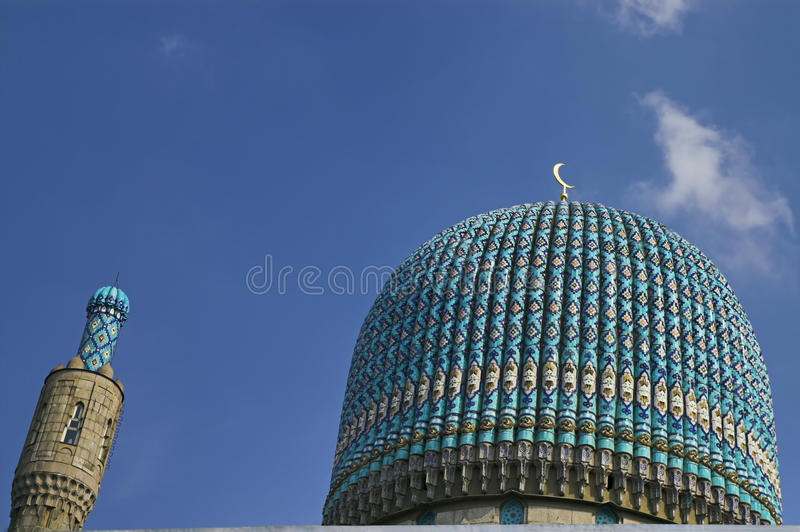 Minaret. The minaret and the front wall with Arabic mosaics of the ancient mosque in Saint Petersburg, Russia royalty free stock photos