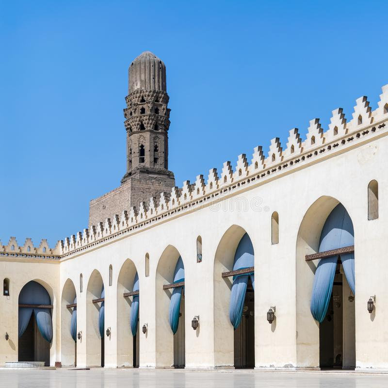 Minaret of historic Al Hakim Mosque known as The Enlightened Mosque, Moez Street, Old Cairo, Egypt. Minaret of public historic Al Hakim Mosque known as The stock photo