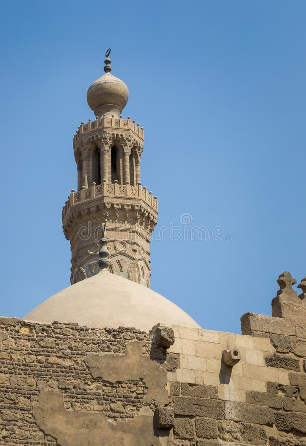 Minaret of historical Mamluk era El Zaher Cairo, Egypt. Minaret of public historical Mamluk era El Zaher Barquq Mosque, Moez Street, Cairo, Egypt royalty free stock photo