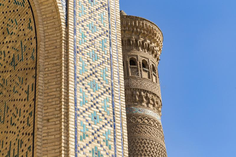Minaret Kalyan. One of the greatest buildings in the East. Great minaret or Minaret of Death. Covered with different shape ceramic. Tiles: square, circle, half royalty free stock image