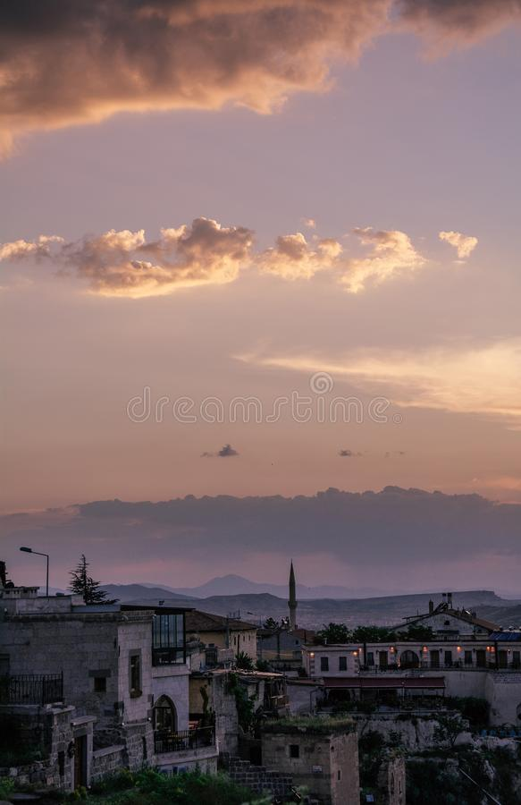 Minaret of the mosque and pink sunset sky on a background in Cappadocia. Turkey. stock photography