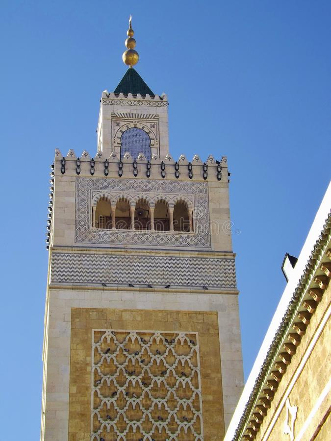 Minaret of a mosque in Tunis, Tunisia. The Al-Zaytuna Mosque is situated in the Medina of Tunis stock photography