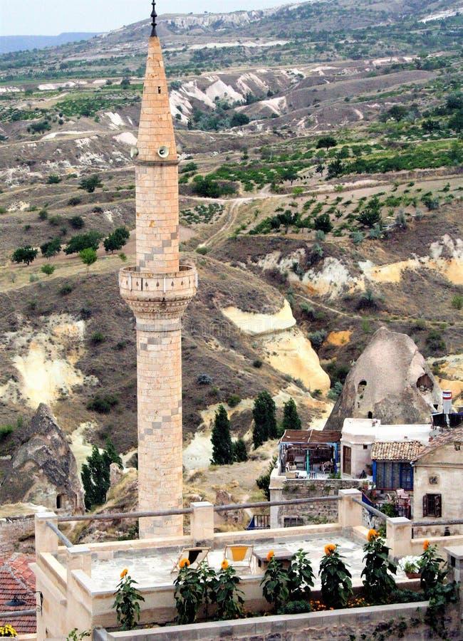 Minaret overlooking the valley of Uchisar in Cappadocia , Turkey. Spectacular landscape of Uchisar valley , Cappadocia, Turkey royalty free stock image