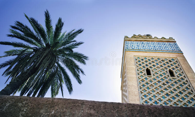 Minaret and palm tree with clear blue sky stock images