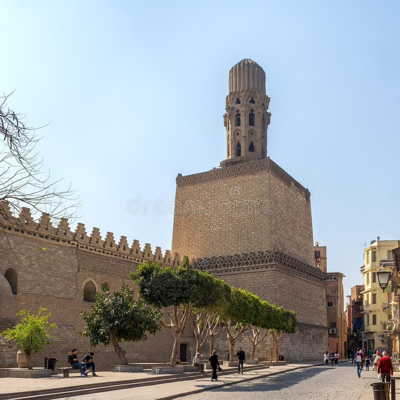 Minaret of public historic Al Hakim Mosque - The Enlightened Mosque, Moez Street, Cairo, Egypt. Cairo, Egypt- March 21 2015: Minaret of public historic Al Hakim stock photos