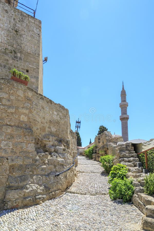 Minaret of suleiman`s mosque view from under medieval clock tower Rhodes stock images