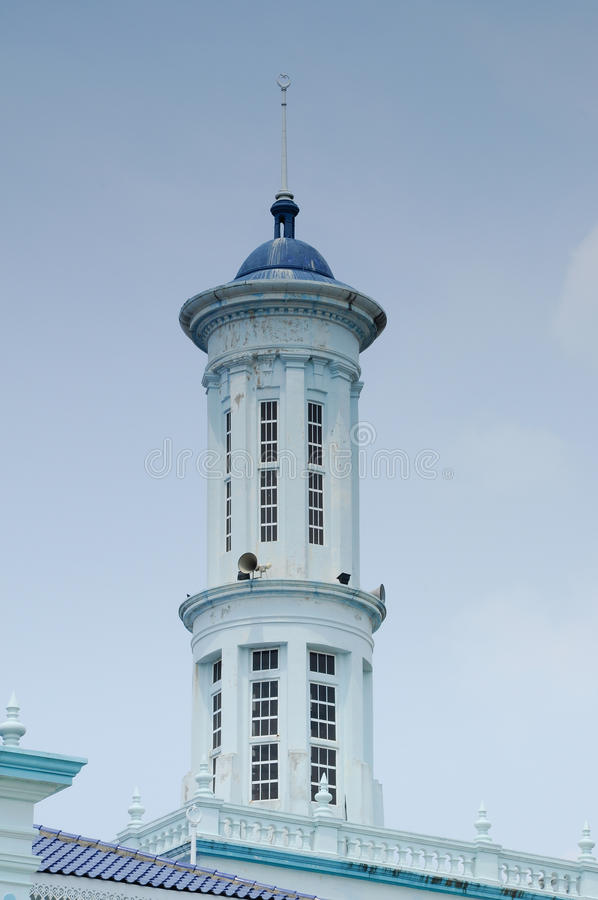 Minaret of Sultan Ismail Mosque in Muar. JOHOR, MALAYSIA – JANUARY, 2014: Sultan Ismail Mosque also known as Muar 2nd Jamek Mosque is next to Tanjung Agas stock image