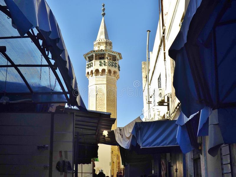 Minaret in Tunis, Tunisia. Street Scene with market stalls in front stock photos