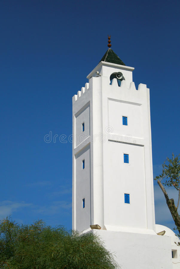 The minaret of tunisian Mosque royalty free stock photography