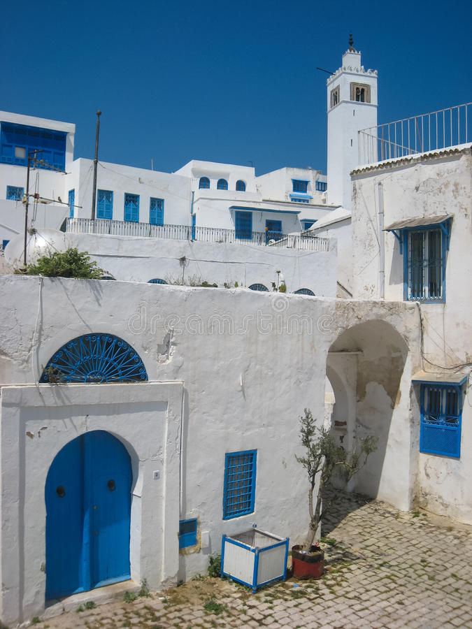 Minaret and blue windows. Sidi Bou Said. Tunisia royalty free stock photo