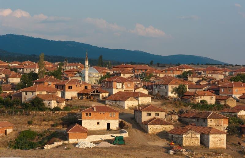 Minareto in villaggio rurale di Anatolia, Turchia fotografia stock