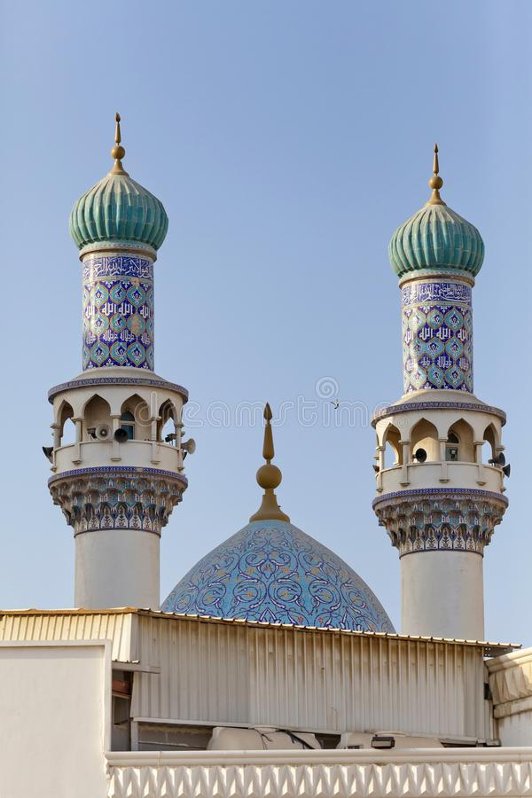 Minarets and dome of the mosque against blue skies. Minarets and domes of the mosque against blue skies in Sharjah, UAE royalty free stock photography