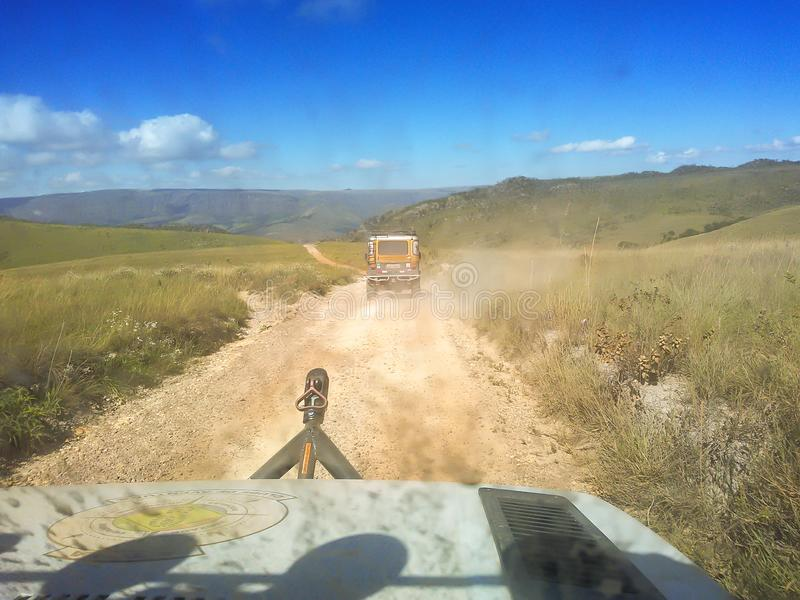 Minas Gerais/Brazil: inside car view, jeeps on dirt road in the mountains stock images