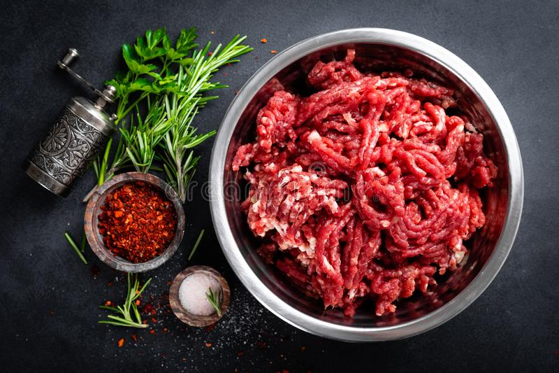 Mince. Ground meat with ingredients for cooking. Top view stock image