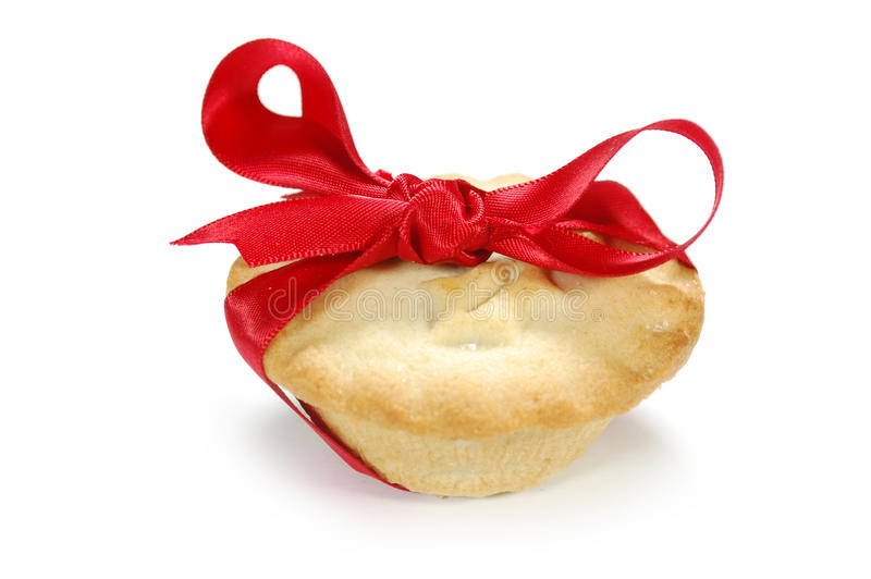 Mince pie. Ribbon bow wrapped tied around a mince pie royalty free stock photography