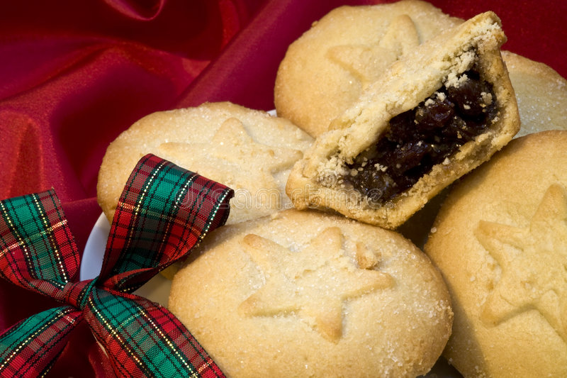 Mince pies. With Christmas ribbon on red background stock image
