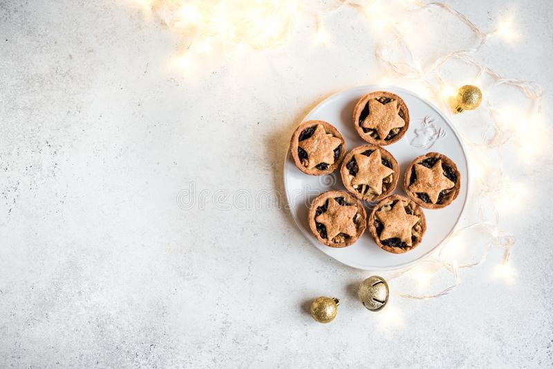 Mince Pies for Christmas. On white background with light, copy space. Traditional Christmas dessert - fruit mince pies stock images