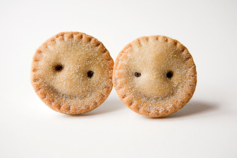 Mince pies (are they smiling...). Smiling (?) Mince pies - shallow dof stock photography