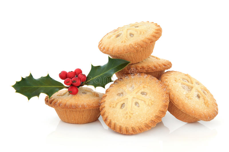 Mince Pies. With snowflake design and holly berry leaf sprig over white background stock photography