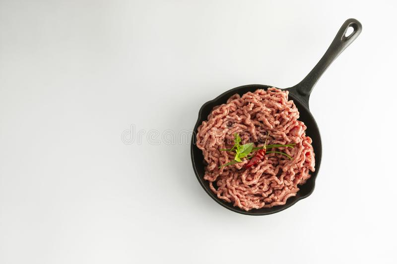 Minced beef red uncooked meat cooking ingredient hambruger steak white background copy space. For text, lunch, top, view, pan, fry, isolated, flat, lay royalty free stock image