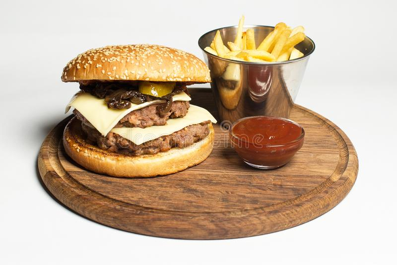 Minced burger with sauce and potato royalty free stock image